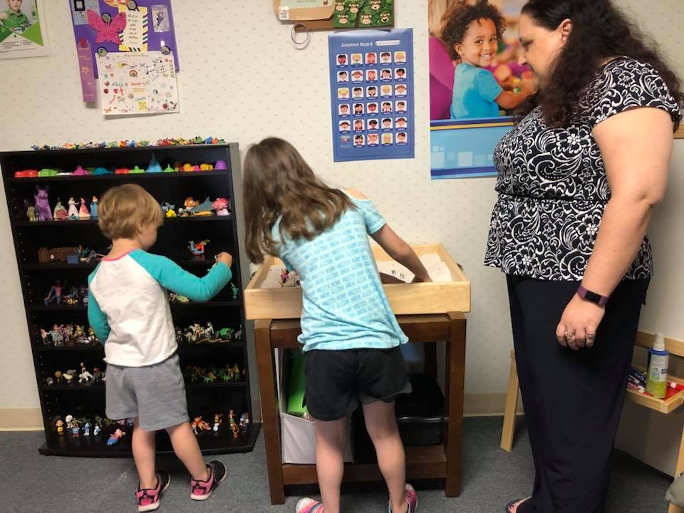 Play therapy room and toys with children and Play Therapist Kim Feeney of Butterfly Beginnings Counseling