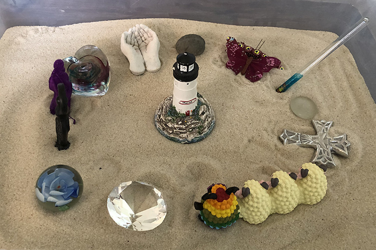 Sand tray for play therapy at Butterfly Beginnings Counseling in Davenport, Iowa