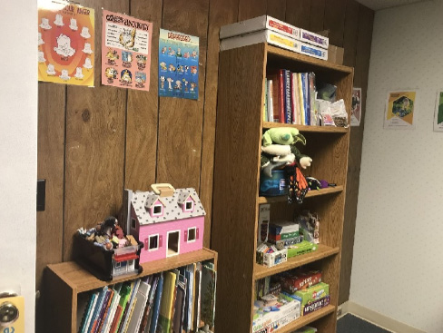 Play Therapy books and toys in a room at Butterfly Beginnings Counseling