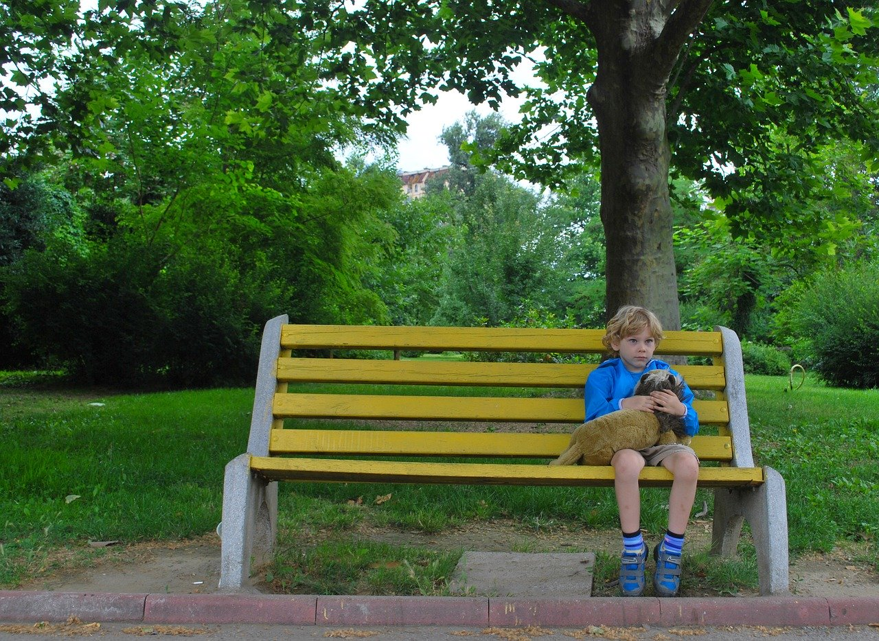 Sad child on bench for tips on coping with change from Butterfly Beginnings Counseling and Play Therapy in Davenport, Iowa