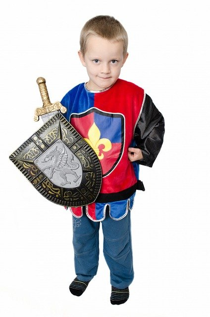 Child in costume for pretend play tips from Butterfly Beginnings Counseling and Play Therapy in Davenport, Iowa