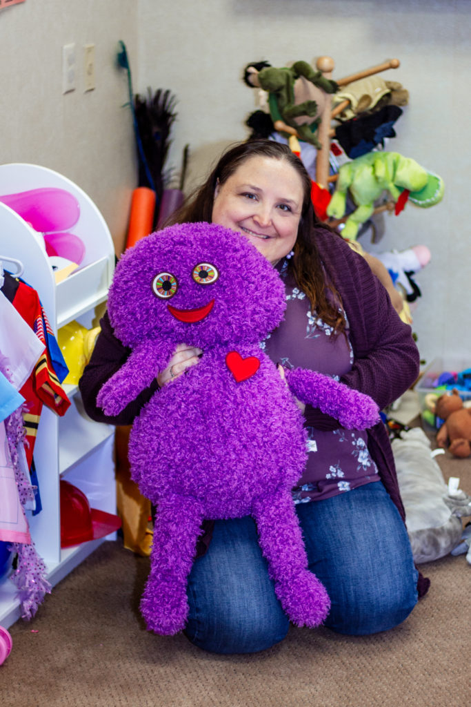 Butterfly Beginnings Play Therapy in Davenport, Iowa Kim Feeney Holds Toy