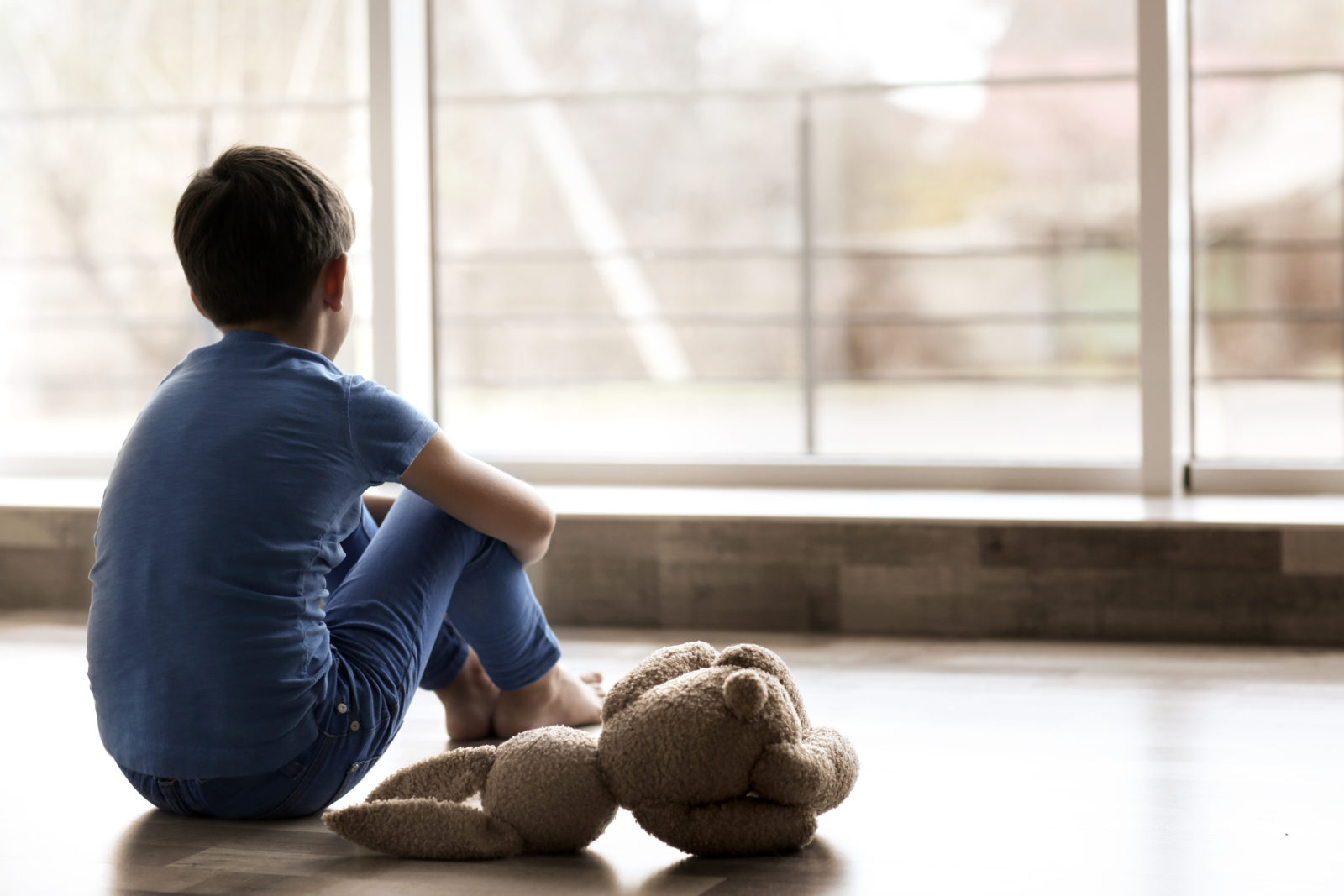 Image of Depressed Child from Butterfly Beginnings Play Therapy in Davenport, Iowa Kim Feeney